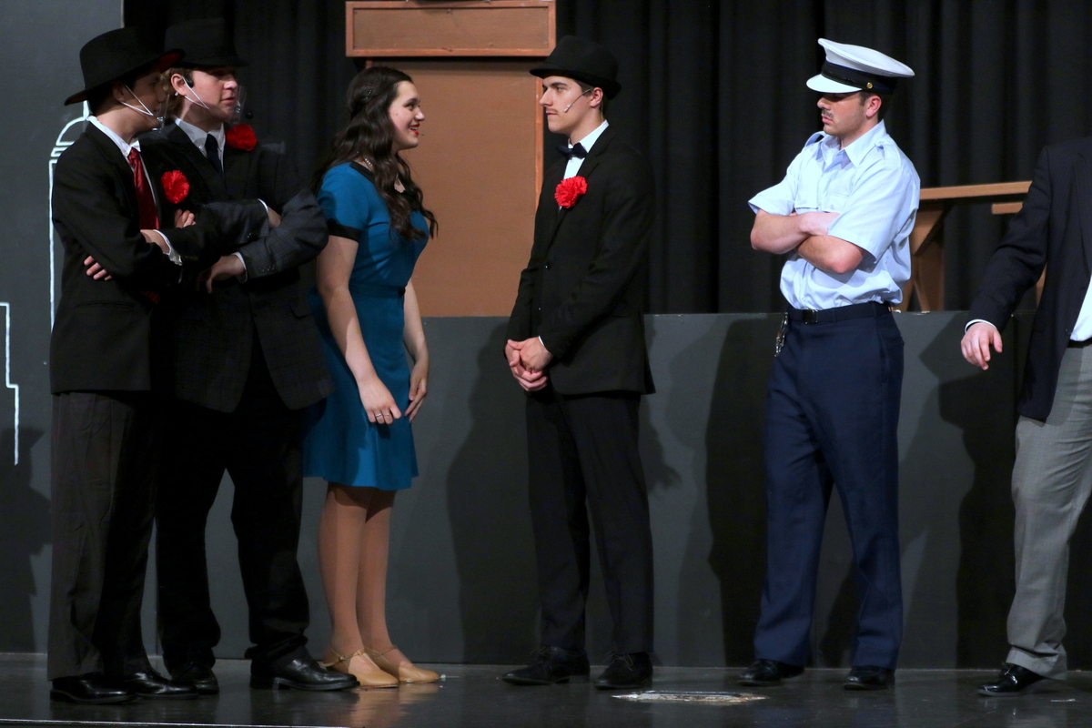Guys and Dolls cast members on stage